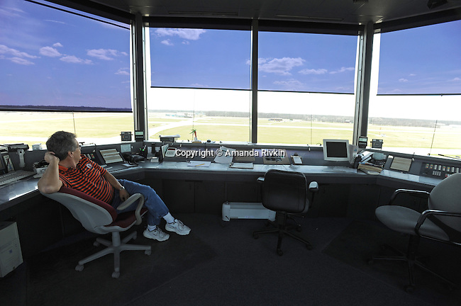 """Mick Moore mans the air traffic controller's tower at the Elkhart Municipal Airport in Elkhart, Indiana on April 8, 2009.  As part of the """"bail out"""" funds, one of two runways will be repaired; airport manager Andy Jones said he had to turn down the request from Air Force One and the president's advance staff, citing the weight of the aircraft and the fragile state of the runways, to land at Elkhart Municipal Airport."""