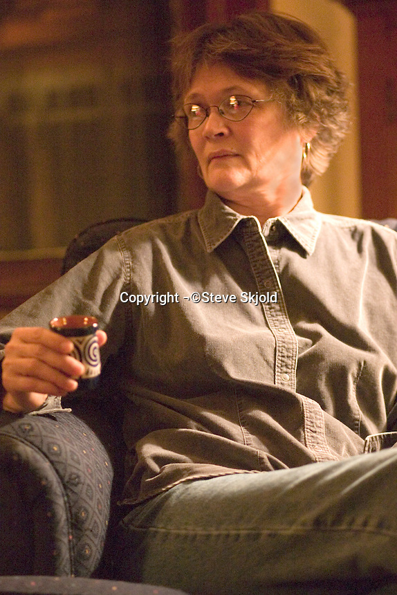 Woman age 59 enjoying her after dinner expresso and the good life.  St Paul Minnesota USA