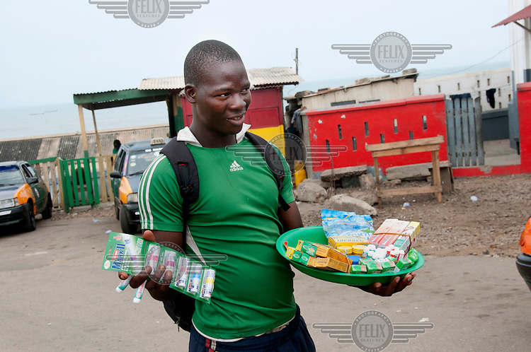 A young man hawking pharmaceutical products on the streets of Accra.