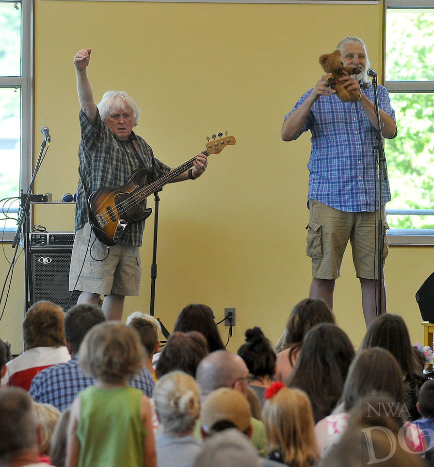 NWA Democrat-Gazette/MICHAEL WOODS &bull; @NWAMICHAELW<br /> Keith Grimwood (left) and Ezra Idlet, from Trout Fishing in America preform a show for kids Saturday, August 1, 2015 at the Fayetteville Public Library. The annual end of the year celebration for the summer reading program featured the popular kids band and prizes for the program participants.