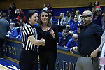 DURHAM, NC - DECEMBER 29: Duke head coach Joanne P. McCallie (center) with assistant coach Hernando Planells (right) and referee Meadow Overstreet (left). The Duke University Blue Devils hosted the Liberty University Flames on December 29, 2017 at Cameron Indoor Stadium in Durham, NC in a Division I women's college basketball game. Duke won the game 68-51.
