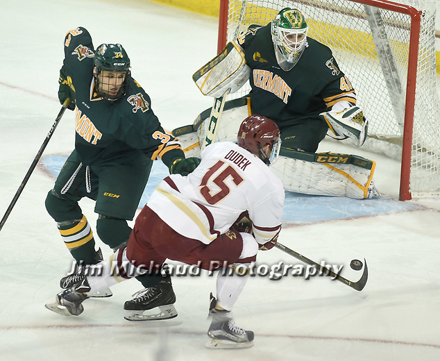 (Boston MA 03/10/17) BC 15, JD Dudek, gets this goal attempt stopped by Vermont goalie Stefanos Lekkas,  during the first period, Friday, March 10, 2017, at Conte Forum. Herald Photo by Jim Michaud