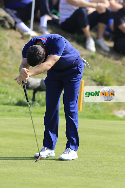 Rory McIlroy Team Europe misses his putt to save the match on the 16th green during Friday's Fourball Matches at the 2018 Ryder Cup, Le Golf National, Iles-de-France, France. 28/09/2018.<br /> Picture Eoin Clarke / Golffile.ie<br /> <br /> All photo usage must carry mandatory copyright credit (© Golffile   Eoin Clarke)