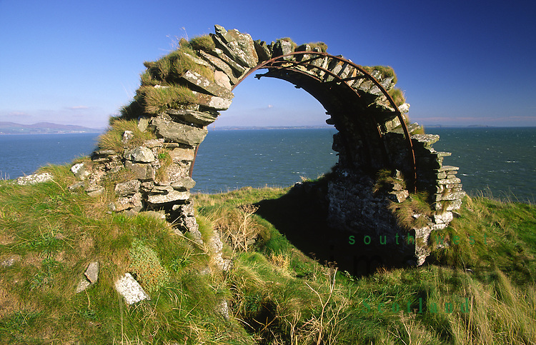 The last remain of Cruggleton Castle above 200 foot cliffs on the edge of Wigtown Bay near Garlieston in the Machars of Galloway looking across to the Stewartry coast Scotland UK