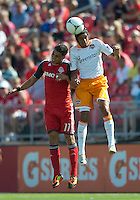 July 28, 2012: Houston Dynamo forward Calen Carr #3 and Toronto FC midfielder Luis Silva #11in action during a game between Toronto FC and the Houston Dynamo at BMO Field in Toronto, Ontario Canada..The Houston Dynamo won 2-0.