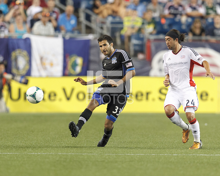 San Jose Earthquakes defender Steven Beitashour (33) passes the ball as New England Revolution midfielder Lee Nguyen (24) defends. In a Major League Soccer (MLS) match, the New England Revolution (white) defeated San Jose Earthquakes (black), 2-0, at Gillette Stadium on July 6, 2013.