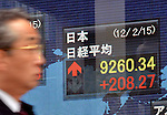 February 15, 2012, Tokyo, Japan - A pedestrian walks by the market quotes at a local brokerage in Tokyo on Wednesday, February 15, 2012. Tokyo stocks rose sharply with the Nikkei Stock Average surging 208.27 points to end the day at 9,260.34, the highest level since the benchmark index reached 9,299 on August 5, 2012. (Photo by Natsuki Sakai/AFLO) AYF -mis-