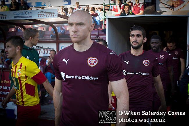 Heart of Midlothian 1 Birkirkara 2, 21/07/2016. Tynecastle Park, UEFA Europa League 2nd qualifying round. Home players Conor Sammon and Igor Rossi Branco walking out on to the pitch at Tynecastle Park, Edinburgh before Heart of Midlothian played Birkirkara of Malta in a UEFA Europa League 2nd qualifying round, second leg. The match ended in victory for the Maltese side by 2-1 and they progressed on aggregate after the first match had ended 0-0. The game was watched by 14301 spectators, including 56 visiting fans of Birkirkara. Photo by Colin McPherson.