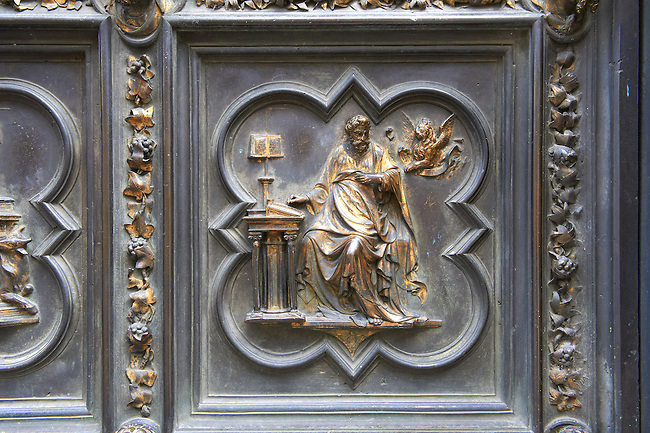 Scenes from the early Renaissance south door of the Baptistry of Florence ( Battistero di San Giovanni ) made by Andrea Pisano in 1329 showing scenes from the life of John The Baptist , made in bronze and guilded in gold. The Bapistry of the Duomo, Florence Italy
