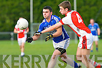 Cieran Doona Laune Rangers is tackled by Conor O'Keeffe Rathmore during their division 1 clash in Killorglin on Saturday