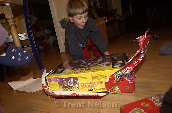 Noah Nelson and Nathaniel Nelson opening presents on Christmas. 12.25.2001, 7:54:56 AM<br />