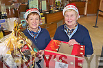 Margaret Collins and Norma O'Connor of Abbeyfeale Credit Union preparing for their annual Christmas draw last Thursday.