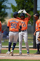 Houston Astros Yorbin Cueta (53) high fives Rhandall Sanchez (92) during a Minor League Spring Training Intrasquad game on March 28, 2019 at the FITTEAM Ballpark of the Palm Beaches in West Palm Beach, Florida.  (Mike Janes/Four Seam Images)