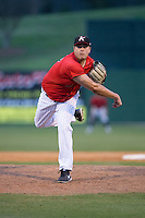 Kannapolis Intimidators relief pitcher Taylore Cherry (43) follows through on his delivery against the Hickory Crawdads at Kannapolis Intimidators Stadium on April 10, 2016 in Kannapolis, North Carolina.  The Intimidators defeated the Crawdads 10-3.  (Brian Westerholt/Four Seam Images)