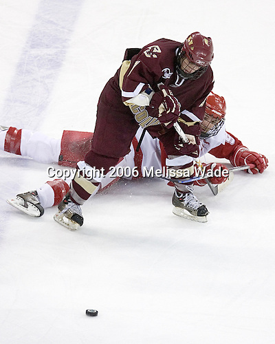 Nathan Gerbe 9 of Boston College is tied up by Jeff Likens 5 of the University of Wisconsin. The Boston College Eagles defeated the University of Wisconsin Badgers 3-0 on Friday, October 27, 2006, at the Kohl Center in Madison, Wisconsin in their first meeting since the 2006 Frozen Four Final which Wisconsin won 2-1 to take the national championship.<br />