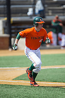 Zack Collins (0) of the Miami Hurricanes hustles down the first base line against the Wake Forest Demon Deacons at Wake Forest Baseball Park on March 22, 2015 in Winston-Salem, North Carolina.  The Demon Deacons defeated the Hurricanes 10-4.  (Brian Westerholt/Four Seam Images)