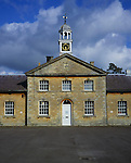 Clock-tower in stable block building at Hartham Park, Wiltshire, England, UK