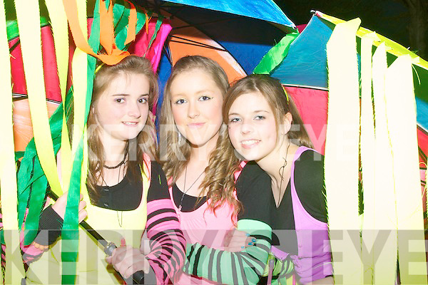 UMBERLLAS: The Camp youth Club who marched in the Samhlai?ocht Easter Parade on Sunday night in Tralee as Umberllas, l-r: Laura Fitzgerald, Emma Herlihy and Jean Farrell...