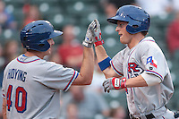 Jared Hoying (40) congratulates Jim Adduci (24) of the Round Rock Express after scoring during the Pacific Coast League game against the Oklahoma City RedHawks at Chickashaw Bricktown Ballpark on June 14, 2013 in Oklahoma City ,Oklahoma.  (William Purnell/Four Seam Images)