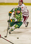 24 November 2013: University of Vermont Catamount Defenseman Chris Muscoby, a Freshman from Airdrie, Alberta, in third period action against the University of Massachusetts Minutemen at Gutterson Fieldhouse in Burlington, Vermont. The Cats wore special camouflage jerseys to celebrate Military Appreciation Day. The game-worn jerseys were auctioned off with proceeds benefiting the Vermont Veterans Fund (VVF). The Catamounts shut out the Minutemen 2-0 to sweep the 2-game home-and-away weekend Hockey East Series. Mandatory Credit: Ed Wolfstein Photo *** RAW (NEF) Image File Available ***