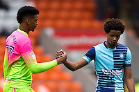 Jamal Blackman of Wycombe Wanderers with Sido Jombati during the Sky Bet League 2 match between Blackpool and Wycombe Wanderers at Bloomfield Road, Blackpool, England on 20 August 2016. Photo by James Williamson / PRiME Media Images.