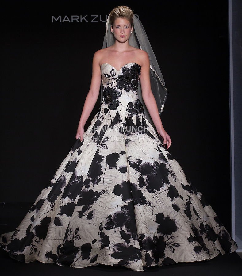 Model walks runway in a bridal gown from the Mark Zunino 2016 collection during New York Bridal Fashion Week Spring 2016.