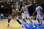 31 December 2014: Wofford's Justin Gordon (24) is defended by Duke's Marshall Plumlee (40) and Jahlil Okafor (15). The Duke University Blue Devils hosted the Wofford College Terriers at Cameron Indoor Stadium in Durham, North Carolina in a 2014-16 NCAA Men's Basketball Division I game.