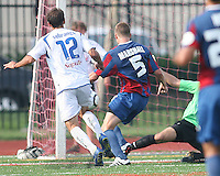 Andrew Marshall #5 and Evan Bush #1 of Crystal Palace Baltimore watch a shot by Eduardo Sebrano #12 of the Montreal Impact go into the net for a goal during an NASL match at Paul Angelo Russo Stadium in Towson, Maryland on August 21 2010. Montreal won 5-0.