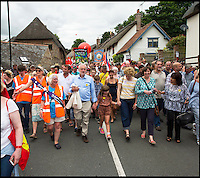 BNPS.co.uk (01202 558833)<br /> Pic: PhilYeomans/BNPS<br /> <br /> Corbyn leads the annual march through the Dorset village.<br /> <br /> There was no escape for beleaguerd Labour leader Jeremy Corbyn even in the bucolic surroundings of the Tolpuddle Martyrs rally in the heart of Dorset.<br /> <br /> Labour Party member Claire Cavendish climbed a gravestone to deliver a vitriolic attack on the controversial leader , demanding he should step down, just after he had laid a wreath on a martyrs grave in the village churchyard.<br /> <br /> Jeremy Corbyn is a regular visitor to the famous rally that is seen as a key event in the founding of the Trade Union movement.