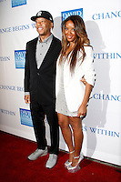 LOS ANGELES, CA - DEC 3: Russell Simmons, Angela Simmons at the 3rd Annual 'Change Begins Within' Benefit Celebration presented by The David Lynch Foundation held at LACMA on December 3, 2011 in Los Angeles, California