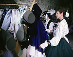 Civil  War Southern Belles, Margaret Williams , right, and her daughter Debbi Williams looks over a rack of 1860 era clothes after a Civil War re-enactment for the the Battle of Fort Morgan, Mobile, Al in 2001. Jim Bryant Photo. @2001. All Rights Reserved.