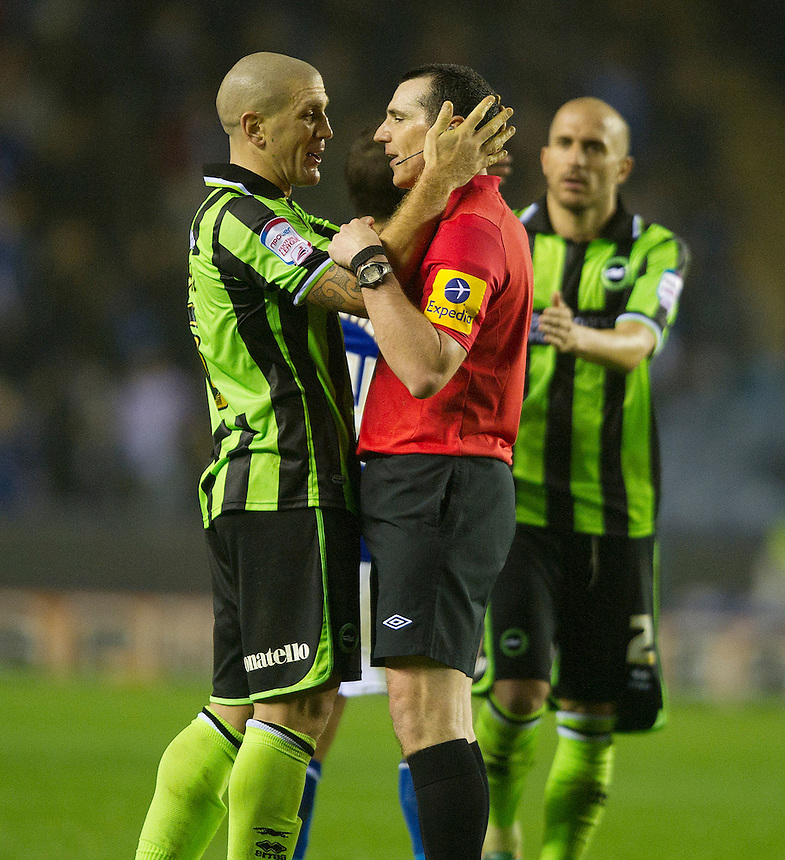 Brighton and Hove Albion's Adam El-Abd up close and peronal with Referee Mark Halsey..Football - npower Football League Championship - Leicester City v Brighton and Hove Albion - Tuesday 23rd October 2012 - King Power Stadium - Leicester..