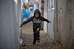 A Yazidi boy runs between shelters in a camp for internally displaced persons at Dawodiya in Iraq's Kurdistan region. More than 600 Yazidi families living in the camp escaped from their communities in the Sinjar region during the attempted genocide by the Islamic State group. Although ISIS was militarily defeated in 2017, camp residents say it's still not safe to return home, nor do they have sufficient resources to rebuild their homes.<br /> <br /> The Lutheran World Federation, a member of the ACT Alliance, provides water, sanitation, garbage collection, and psycho-social support for the families in the camp.