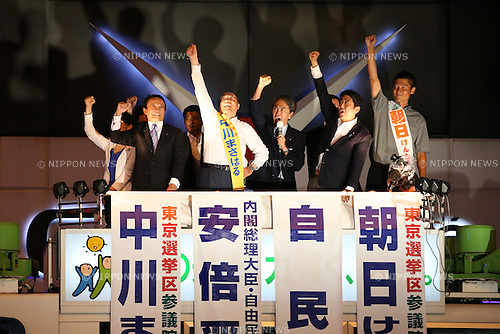 Japanese Prime Minister and ruling Liberal Democratic Party (LDP) president Shinzo Abe, 2nd right, attends a stump speech in support of local LDP candidate in Akihabara district, Tokyo, Japan on July 9, 2016. Japan's Upper House election will be held on July 10. (Photo by AFLO)