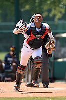 GCL Braves catcher Alejandro Flores (50) tracks down a foul ball during a game against the GCL Blue Jays on June 27, 2014 at the ESPN Wide World of Sports in Orlando, Florida.  GCL Braves defeated GCL Blue Jays 10-9.  (Mike Janes/Four Seam Images)