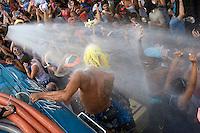 Rio de Janeiro street carnival, Botafogo neighborhood - water jet for refreshing revelers in Rio summer, Brazil.