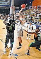 Florida International University center Gilles Dierickx (15) plays against Coastal Carolina University.  FIU won the game 64-62 on November 26, 2011 at Miami, Florida. .