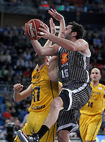Herbalife Gran Canaria's Spencer Nelson (l) and Uxue Bilbao Basket's Alex Mumbru during Spanish Basketball King's Cup match.February 07,2013. (ALTERPHOTOS/Acero)