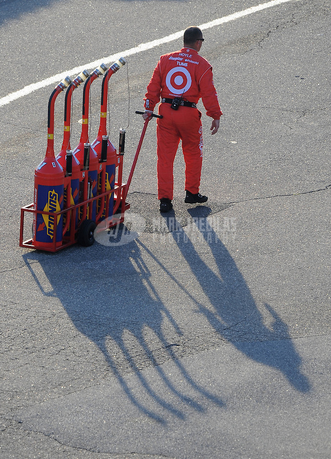 Sept. 21, 2008; Dover, DE, USA; A Nascar Sprint Cup Series gasman takes empty fuel tanks to the garage during the Camping World RV 400 at Dover International Speedway. Mandatory Credit: Mark J. Rebilas-