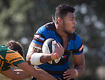 Chris Ofanoa looks for support as he is tackled by Mathew Berry. Counties Manukau Premier Club Rugby game between Onewhero and Pukekohe, played at Onewhero, on Saturday April 05 2014. Onewhero won the game 28 - 23 after leading 17 - 15 at halftime.  Photo by Richard Spranger