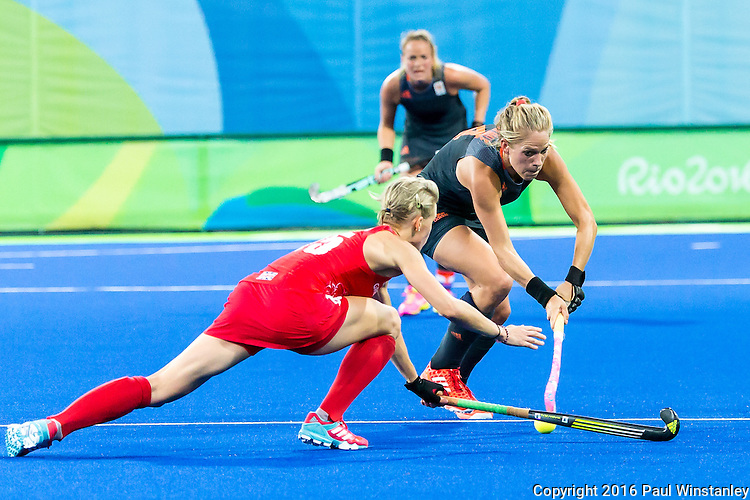 Alex Danson #15 of Great Britain tackles during Netherlands vs Great Britain in the gold medal final at the Rio 2016 Olympics at the Olympic Hockey Centre in Rio de Janeiro, Brazil.