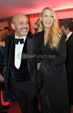 Blake Lively and guest at the Opening Gala Dinner during The 69th Annual Cannes Film Festival on May 11, 2016 in Cannes, France.<br /> CAP/LAF<br /> &copy;Lafitte/Capital Pictures /MediaPunch ***NORTH AND SOUTH AMERICAN SALES ONLY***