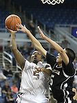 West Wendover's Sean McGahey defends as Agassi Prep's Darryl Green shoots in the NIAA 2A State Basketball Championship game between West Wendover and Agassi Prep high schools at Lawlor Events Center, in Reno, Nev, on Saturday, Feb. 25, 2012. .Photo by Cathleen Allison