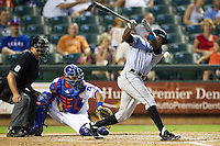 Omaha Storm Chasers outfielder Derrick Robinson #26 swings and hits a foul ball during the Pacific Coast League baseball game against the Round Rock Express on July 22, 2012 at the Dell Diamond in Round Rock, Texas. The Express defeated the Chasers 8-7 in 11 innings. (Andrew Woolley/Four Seam Images).