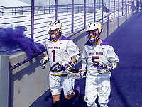 University at Albany Men's Lacrosse defeats Cornell 11-9 on Mar 4 at Casey Stadium.  Tehoka Nanticoke (#1) and Connor Fields (#5) enter the stadium.