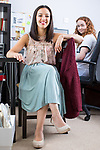 © Joel Goodman - 07973 332324 . 04/08/2017 . Newton-le-Willows , UK . Bunion-sufferer JENNIFER BAILEY (l) , pictured in her home office with Marketing Intern BETH RIGBY (23) (r) , imports custom-made designer shoes manufactured for people with foot conditions which make wearing conventional shoes uncomfortable . Photo credit : Joel Goodman