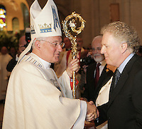 Quebec Premier Jean Charest and Cardinal Marc Ouellet shake hand at the end of Mgr Ouellet farewell Mass in Sainte-Anne-de-Beaupre Basilica, 45 minutes East of Quebec City, August 15 2010. Cardinal Ouellet leaves Quebec for Vatican, as we was recently named Prefect of the Congregation for Bishops and President of the Pontifical Commission for Latin America.