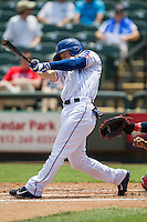 Round Rock Express shortstop Brent Lillibridge #18 swings the bat during the Pacific Coast League baseball game against the Memphis Redbirds on April 27, 2014 at the Dell Diamond in Round Rock, Texas. The Express defeated the Redbirds 6-2. (Andrew Woolley/Four Seam Images)