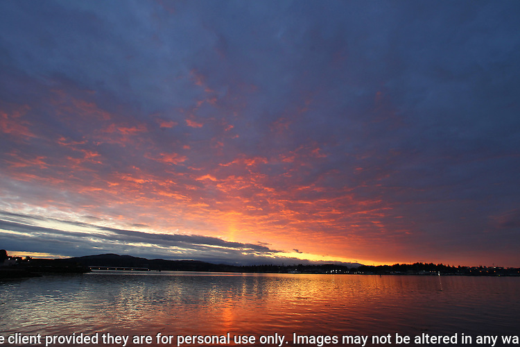 The sky changes colors on the Sinclair Inlet  as sunset sinks behind the Olympic Mountains near Port Orchard, Washington.  Jim Bryant Photo. ©2016. All Rights Reserved.