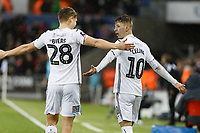 Bersant Celina of Swansea City (R) celebrates his goal with George Byers during the Emirates FA Cup match between Swansea City and Manchester City at the Liberty Stadium, Swansea, Wales, UK. Saturday 16 March 2019